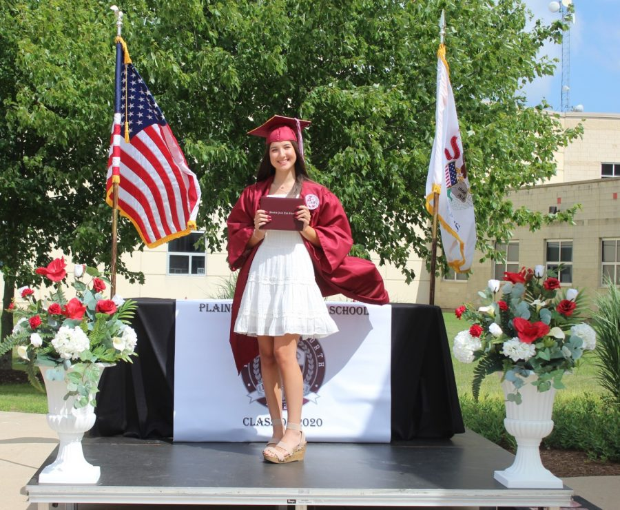 Sydney+Allen+receives+her+diploma+at+the+Drive-through+Graduation+on+Friday%2C+July+17%2C+2020.+Drive-through+Graduations+were+held+in+place+of+traditional+in-person+graduations+which+were+cancelled+due+to+the+COVID-19+pandemic.