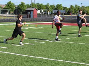 Juniors Dylan Rasmason and Calvin Sharp, and senior Jack Kiefer took part in football drills this summer.