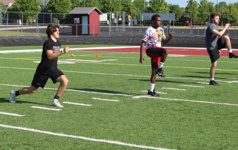 Juniors Dylan Rasmason and Calvin Sharp, and senior Jack Kiefer took part in football drills this summer.