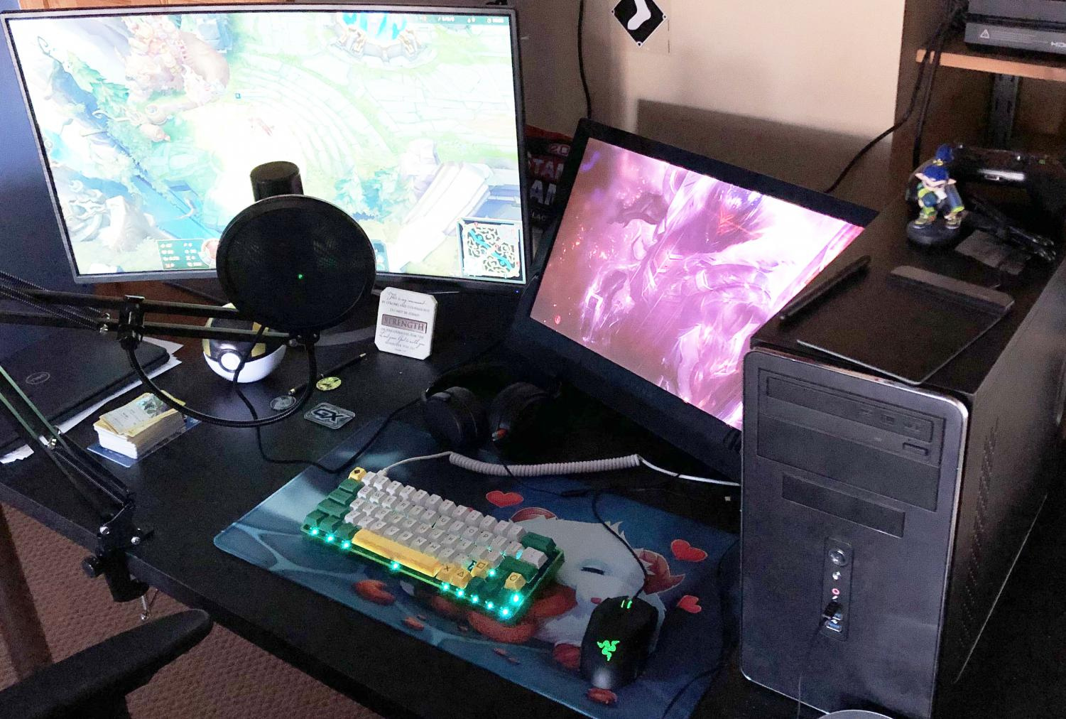The powerful computer of E-Sports member Sean Fuller, who is playing the online multiplayer battle arena game League of Legends.