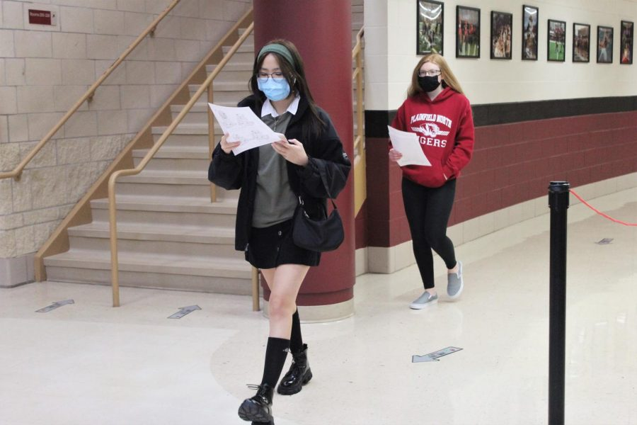 Two Plainfield North High School freshman follow their schedules to find their classes during Freshman Open House on Wednesday, January 28, 2021. District 202 freshman return to in-person learning on Monday, February 1, 2021