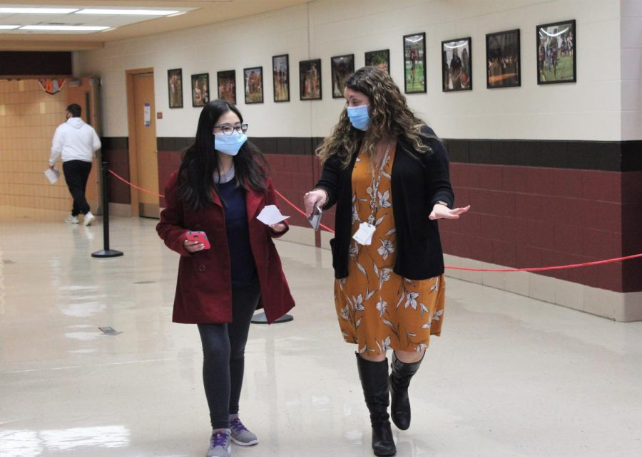 Plainfield North High School Special Education Administrator Shannon McKeague helps a freshman student find her classroom during a Freshman Open House event on Wednesday, January 28, 2021. During Freshman Open House students did a mock walkthrough of their schedules to familiarize themselves with the building.