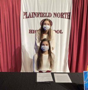 Swimmer Karley Sonennberg poses with her sister, Kendyl, during National Signing Day on Nov. 11