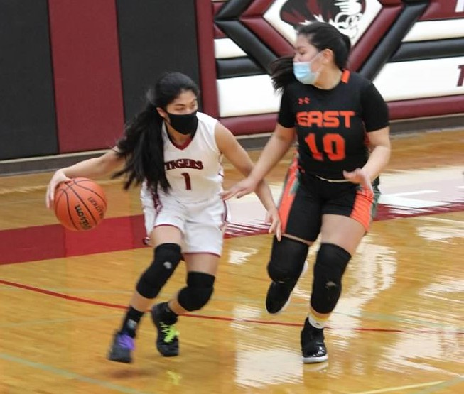 Senior guard Beatrice Atienza escapes a defender in a game against Plainfield East.