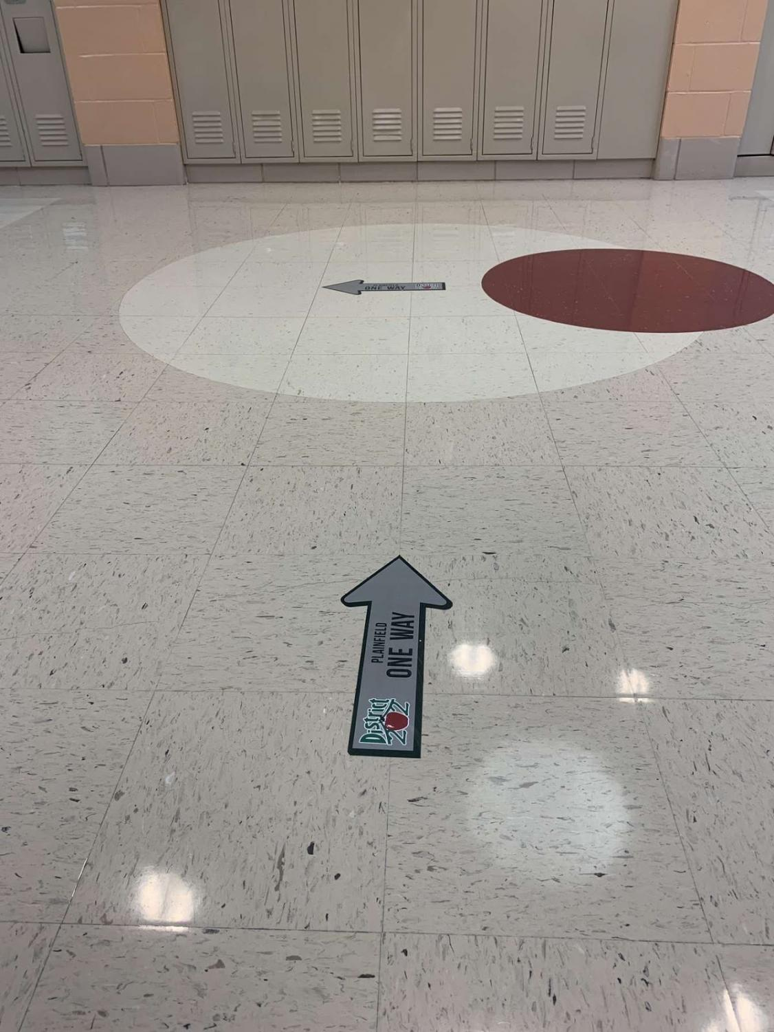 Directional arrows in the hallways to encourage social distancing.