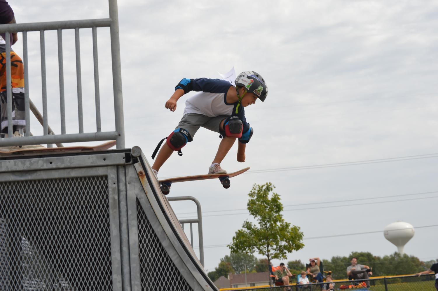 A young skateboard enthusiast displays his skills at a contest held at Bott Community Park and hosted by Jerics Skateshop