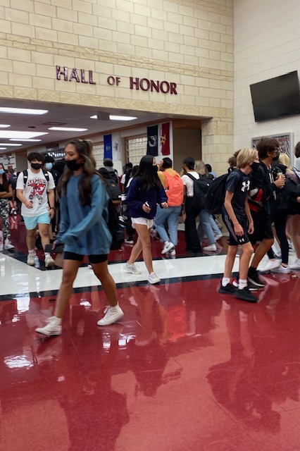 Students fill halls and take on another crowded passing period. The 2021-2022 school year begins with in-person learning. Safety Protocols enforced by administration and staff. Photo by Julia Gerard